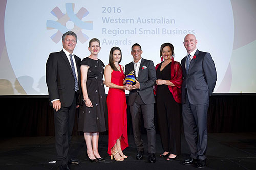 Small Business Development Awards-Wattnow Electrical holding trophy